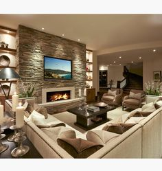 A sectional, lots of pillows and a fireplace, doesn't get cozier then that!! By LMK Interiors