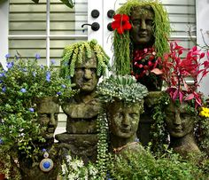 Whimsical sculpture pots for your garden. From Roomzaar: The Cranium Family - 2009