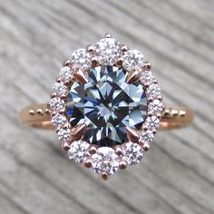 grey moissanite vintage inspired halo engagement ring in rose gold