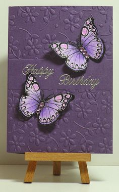 handmade card from Cathys Card Spot: monochromatic purple ... stamped and fussy cut butterflies with raised wings ... sweet flowers on embossing folder background ... wonderful card!