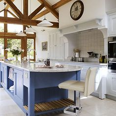 Amazing English Country Kitchen.  White Cabinetry with Dark Blue Island.  And those Trusses!!