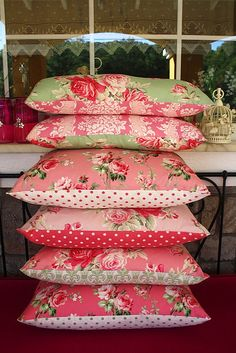pink and green beautiful fabric pillows...love the mix of patterns-These totally scream MARY!!!!