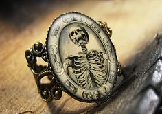 Memento Mori Death Skull Horror Halloween Gothic Glass Bronze Ring 44-AR. $15.99, via Etsy.