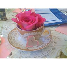 Teacup Table Setting By Jackie Lopez  Like the teacup idea, maybe some tables w teacup, some w mason jar, but stay in same color of flower/etc