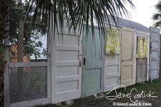 Recycled vintage doors from Tybee Island make great privacy fence