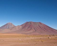 Atacama Desert, Chile - This desolate landscape is freckled with stubborn salt lakes, sand dunes and lava flows, and is an ideal analogue for Mars. The fact that life can still be found here makes it an important location for studying how life might also have survived in the arid soils of the Red Planet.   In fact, rovers have been tested in Atacama to see if their instruments can detect the microbial life that exists there, before they are rocketed off to Mars.