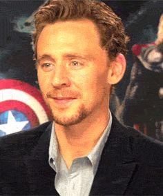 LOL  ... Tom Hiddleston laughing gif