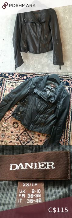 DANIER Black Leather Moto Jacket Size M In amazing condition!!! Incredibly buttery soft leather. Such a classic style - looks amazing over a sweater or blouse with jeans and boots! Size XS, but danier sizing is really odd - so it's actually more like a medium, size 6-8. Sadly just not the right fit for me, so it hasn't had much wear! From a pet and smoke free home 😊 Danier Jackets & Coats Leather Jackets Purple Suede, Purple Leather, Soft Leather, Black Leather, Lambskin Leather Jacket, Leather Trench Coat, Leather Blazer, Italian Leather Jackets, Floral Chiffon Dress