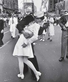 The story behind 'The Kiss' isn't as romantic as most people think. The solider was so happy to be home he was running up to random people and kissing them. Alfred Eisenstaedt just happened to capture this moment when he kissed a young nurse. Still a beautiful photo that captures the atmosphere perfectly.