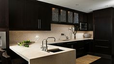 Love the countertop surface extending down the side