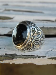 "Man's Sterling Black Onyx Ring. This is almost a ""class ring"" style, which is an interesting idea, because I love my high school ring, but wouldn't be caught dead wearing it 20 years later..."