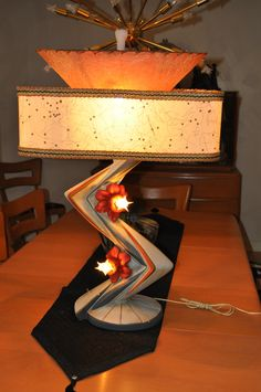 This looks eerily like my lamps, minus the wacky paint job. Continental Art Co. Chalkware Lamp with Atomic Fiberglass Shades Rustic Lamps, Antique Lamps, Vintage Lamps, Industrial Lamps, Mid Century Modern Lighting, Mid Century Modern Decor, Mid Century Design, Atomic Decor, Retro Lampe