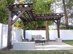unique pergola shape. would look great with vines