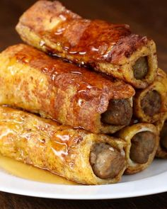 Servings: 3INGREDIENTS10 slices sandwich breadCooked sausage links3 eggs1 tablespoon milk½ teaspoon cinnamon½ teaspoon vanilla extractPREPARATION# Roll each slice of bread flat with a rolling pin.# Place sausage at the edge of the bread, and roll up.# In a bowl, combine eggs, milk, cinnamon, and vanilla.# Dip each roll-up in egg mixture, and pan fry in a buttered skillet until all sides are golden brown.# Enjoy!Inspired by…