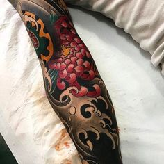 Really like this Japanese tattoo sleeve. Anywhere where there is heavy black work seems to make the color work really stand out #CuratedTattoos.