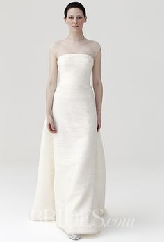 A simple @peterlangner wedding dress with an illusion neckline | Brides.com