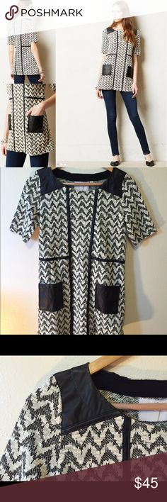 """Anthropologie Postmark Hida Tunic B&W VeganLeather Hida Tunic by Postmark XS. EUC. Self: 60% cotton/40% polyester Contrast: polyurethane  Bust: 16.5"""" Length: 28.5""""   Sleek with leggings and street-smart with skinny jeans, tunics (like this geometric, vegan leather accented one) are on our radar. Anthropologie Tops Tunics"""