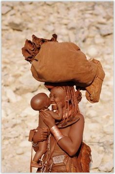 This actually my tribe but I am modern Himba mother and child, Namibia. BelAfrique your personal travel planner - www.BelAfrique.com