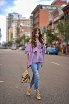 A vision in purple, Paola Alberdi balances the volume of this retro gingham blouse with slim, frayed denim and a white and gold choker. We love how her sunglasses are channelling style icon Penny Lane. Choker and Shirt: Shopbop, Shoes: Aquazzura, Bag: Céline