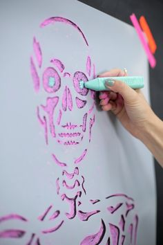 How to DIY a Skeleton Backdrop For Your Halloween Party