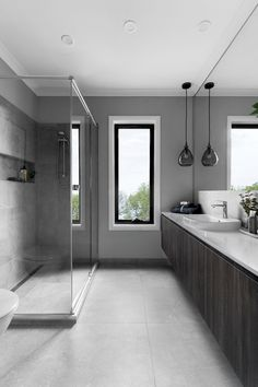 A palette of grey tiles and dark timber cabinetry convey a contemporary theme. Recessed shower shelving bring the functionality to this gorgeous bathroom. Modern Bathroom Decor, Contemporary Bathrooms, Bathroom Interior, Bathroom Renos, Budget Bathroom, Master Bathroom, Bathroom Inspiration, Bathroom Inspo, Bathroom Designs
