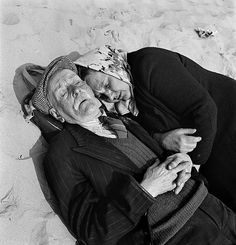 Love doesn't care how old you are. Nap time on the beach at Blackpool 1946.