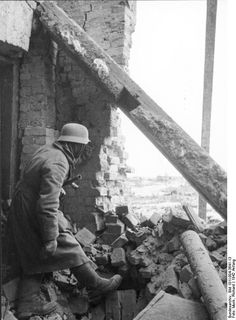 A German soldier engaged in an urban battle somewhere on the Eastern front, 1942.