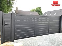 This driveway design is genuinely a magnificent design approach. House Fence Design, Front Gate Design, Modern Fence Design, Door Gate Design, Driveway Design, Garage Door Design, Driveway Gate, Sliding Fence Gate, Front Gates