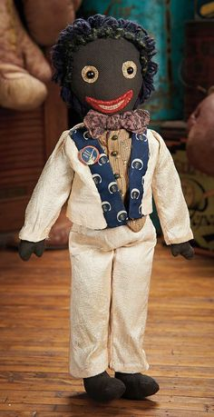 View Catalog Item - Theriault's Antique Doll Auctions Lot: 279. American Black Cloth Folk Doll with Embroidered Features