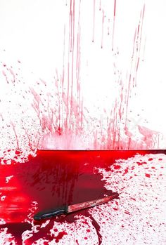 Stock image of 'Halloween concept : Bloody knife with blood splatter'