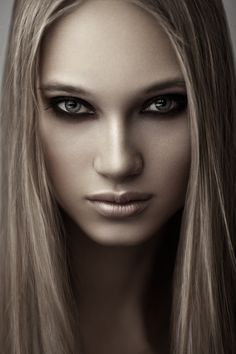 Like the tonal quality in this photo...almost a sepia feel to it...beautiful.-make up flawless