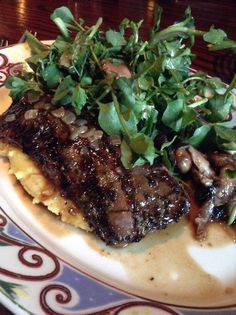 Churrasco a la Cubana (Chimichurri marinated grilled skirt steak, roasted garlic boniato-potato mash, parsley, lemon and onion sauce. Watercress and mushroom escabéche salad) - at Cuba Libre, Washington DC