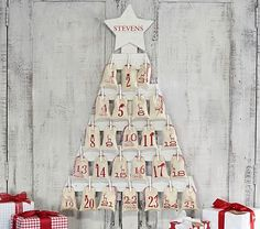 Wooden Tree Advent Calendar - looks pretty simple to make...wood, clothes bins, mini bags...