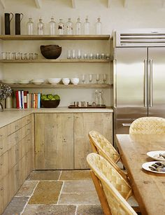 I love the natural colors in this kitchen!  Access to everything. Open feel when you have low ceilings.