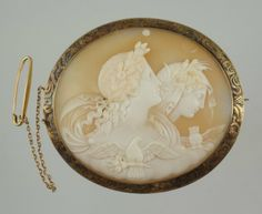 Oval Carved Shell Cameo Depicting Two Women With A Bird, Mounted In Engraved 14k Gold