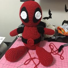 My current WIP. Need to attach his legs and swords!  #crochet #crocheted #crocheter #crocheting #crochethook #crochetaddict #amigurumi #deadpool #awesome #lovetocrochet #addicted #fun #creative #inspiration #red #black #marvel #notasuperhero by undead.glamour