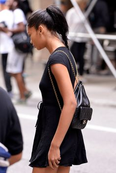 Chanel Iman wearing the cutest mini Chanel backpack with her jersey dress, while strolling the streets of LA.