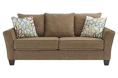 """The Corson Sofa from Ashley Furniture HomeStore (AFHS.com). The """"Corson-Mocha"""" upholstery collection beautifully captures the modern style of exciting contemporary design with the flared track style arms and welting accents all perfectly surrounded within a soft textured upholstery fabric in a vibrant color that is sure to awaken any living room décor."""