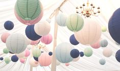 We suspended Navy, Pink, Mint, White & Pale Blue Paper Lanterns in the Marquee at Middleton Lodge for this gorgeous Wedding www.weddingandevents.co.uk North Yorkshire Wedding Flowers