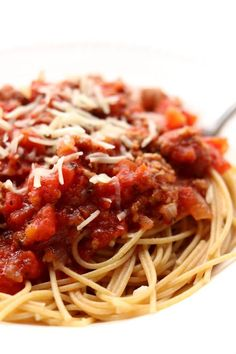 Instant Pot Homemade Spaghetti Sauce--a meaty pressure cooker spaghetti sauce that only takes 10 minutes under pressure to taste like a sauce that has simmered all day. I like to serve this sauce over any pasta or over spaghetti squash.