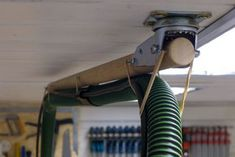 DIY ceiling mounted boom to hold a vac hose (or maybe a light or something). Made out of a swivel wheel. Workshop Storage, Workshop Organization, Tool Storage, Garage Workshop, Garage Storage, Woodworking Workshop, Woodworking Jigs, Woodworking Projects, Garage Tools