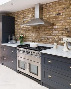 Stunning exposed brickwork highlights the range and beautiful After Midnight Shaker Kitchen Company cabinetry so well. Brick Wall Kitchen, Open Plan Kitchen Living Room, Home Decor Kitchen, Kitchen Interior, New Kitchen, Kitchen Flooring, Home Kitchens, Decorating Kitchen, Metro Tiles Kitchen