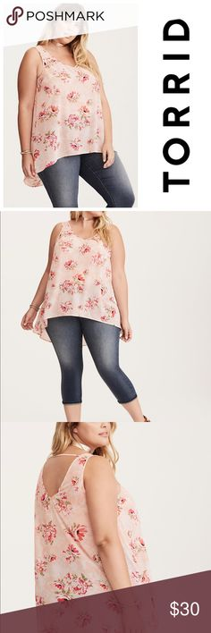 "NWT Torrid Floral Ho Low Top A springy floral print that won't give you the sniffles. This blush pink chiffon top is semi-sheer and totally sweet with a gorgeous floral print. A double v neck and back add some skin appeal, a back strap holds the flowy look together. Torrid size 0.   Model is 5'10"", size 1 Size 1 measures 30"" from shoulderPolyesterWash cold, dry lowImported plus size tank torrid Tops Tank Tops"