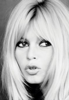 Brigitte Bardot works the smokey eye...  I don't see the resemblance between Michelle Obama's bangs and Bridget's.