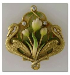 Art Nouveau Swan Pin with Diamonds. Crafted in 14kt gold,  this brooch was created by Krementz & Company around 1900.  Krementz was one of the premier makers of Art Nouveau jewels in the United States.  One of their hallmarks was the use of pastel enamels,  like the soft yellows,  greens and whites of this brooch. | © Copyright Arthur Anderson  2002  -  2015
