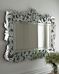Giorgia Venetian-Style Mirror :: Renowned as a center for glassmaking since the 15th century, Venice was home to the artisans of Murano who originated the Venetian mirror. The term refers to a mirror whose frame is composed of layers of mirror that is cut, beveled, & etched by hand. The graceful shapes & ornamentation of Venetian-style mirrors are created today by artisans in Indonesia who have spent years perfecting their techniques & often work more than a week to complete a single mirror.