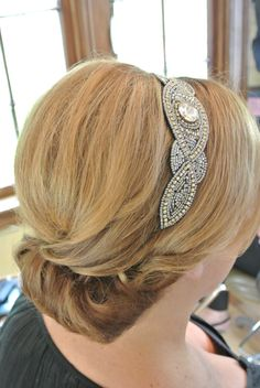 Rolled updo accented with a headband by Pink Pewter. Hair by Joanne Fanelli