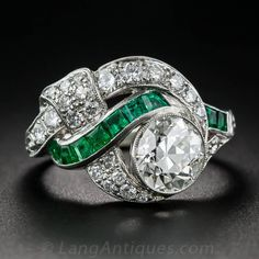 Art Deco 1.97 Carat Center Diamond and Emerald Ring | From a unique collection of vintage engagement rings at https://www.1stdibs.com/jewelry/rings/engagement-rings/