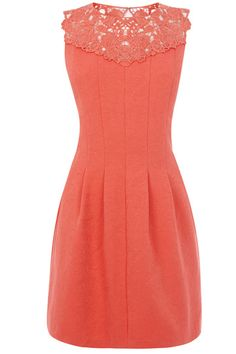 This cute sleeveless dress has a skater style skirt and a lace detail to the neckline with an open back.