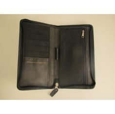 Travel Zip Around Wallet & Passport Holder - Genuine Leather - Black - $45. Donated to East River Development Alliance.